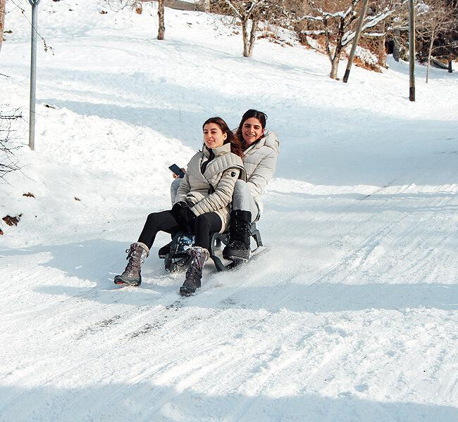 sledding on the snow
